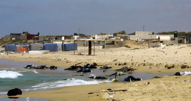 Graphic content: Bodies of African would-be migrants are washed up on the shore of al-Qarboli, about 35 miles east of Tripoli, Libya on Aug. 25. (European Pressphoto Agency)